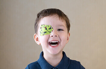 Child with a Lime Green Eye Patch used to fight a Lazy Eye