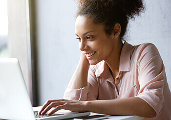 Woman Smiling and researching eye care